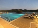 Busuanga Bay Lodge pool area by night